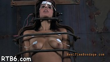Tough lass receives electrifying castigation for her teats
