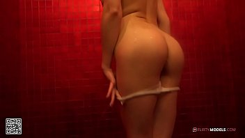 Young blond girl having fun and masturbating under the shower