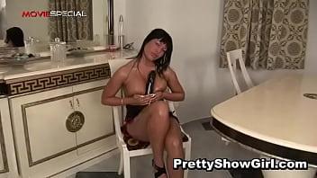 Busty horny slut working on a huge dildo