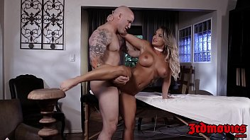 Busty Cali Carter slammed on massage table by big cock hunk