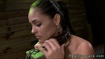 Busty brunette Jasmine Caro chained to a post and deep throat fucked image