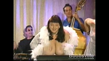 Candye Kane sings and plays the keyboards with her huge tits