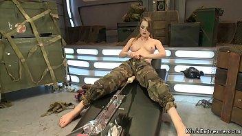 Busty solo soldier fucks machine