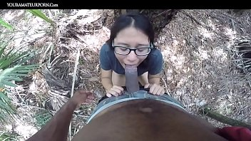 Black man and Asian woman couple fucking outside in wilderness amateurs