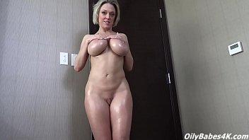 Busty Dee Williams shows off her lubed up tits