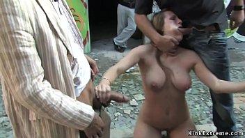 Busty gagged slave posing tied in window