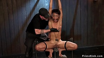 Ebony squirter gets pussy lips clamped