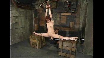 Redhead subdued in bondage rough sex