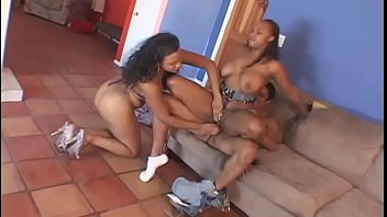 Two horny ebony sluts share one hard tool in the living room