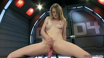 Flexible blonde fucks machine and cums
