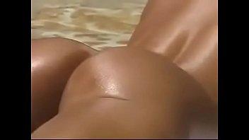 Ashley Lawrence sunbathing by the pool