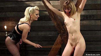 Dominatrix canes and toys bound blonde