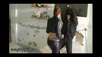 Female asian martial arts Girl in leather pants kick a guy 00