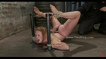 Busty blonde babe tied with hands behind sucking cock in bondage blowjob