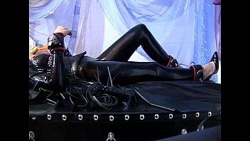 Horny girl in latex pleasuring herself