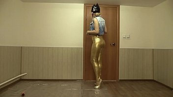 The girl removes gold leggings, smeared with oil and masturbates.