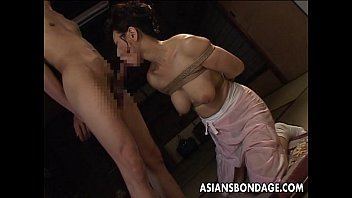 Free bound handjob clips - Bound japanese milf sucks on a hard cock