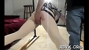 This whore gets her tight pussy stimulated by ropes
