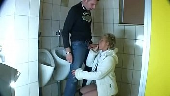 Mature stepmom could not resist and fucked her son in the men's room