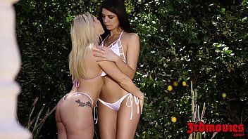 Sensual dykes licking pussy at a private outdoor pool