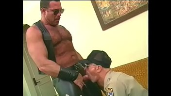 Wearing gay leather chaps in public Muscular bear in leather chaps gets his cock slurped by police