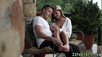 Babe tugs cum on feet