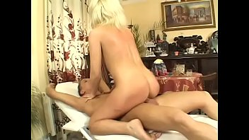 Blonde milf Alexa shoves cock in her ass on a table till she screams with pleasure