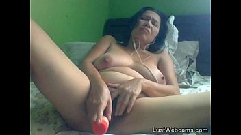 Granny masturbates with dildo on cam