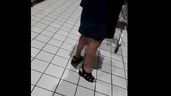 An old and fat slut in the store without panties