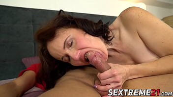 Mature brunette swallows big load after riding young dick