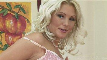 Desirable blonde with big tits enjoys masturbating
