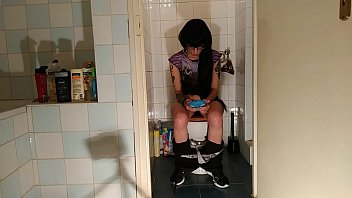 Image: Sexy goth teen pee & shit while play with her phone pt2 HD