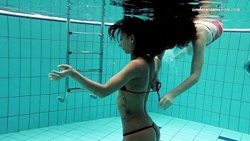 Nina Markova and Zlata Oduvanchik swimming naked in the pool