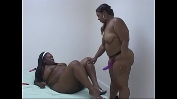 Black BBW sluts Ambers Swallows and Niki Starr fuck with toys and a strap on hardcore