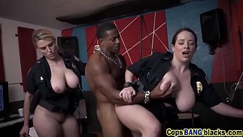 Muscular black stud fucking two busty police officers