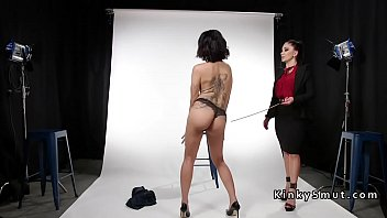 Chained and anal plugged sub gets caned