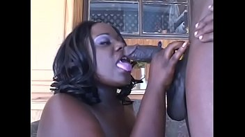 Big long black dicks Fat black woman is on her knees sucking on black cock