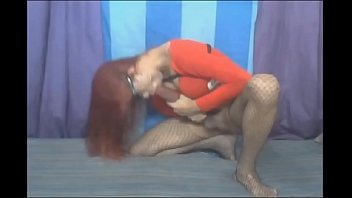 Red haired tranny - Shemale sucking her own giant cock