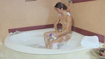 Asian babe in a bath enjoys masturbating