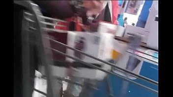 MILF in Tight Jeans at Photo Kiosk