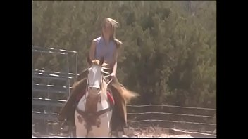 Stunning blonde cutie April Flowers takes lessons of horseback riding and seduces stable-man