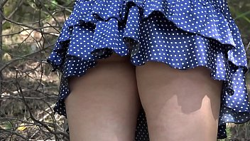 Pussy under short dress Under a skirt without panties. hairy pussy and big ass in a short dress climbs mountains in nature.