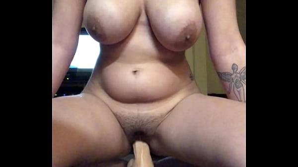 Latina girl bouncing and cumming on 10 inch dildo Thumb