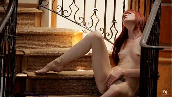 Redhead Elle Alexandra Fingers Herself on the Stairs - EroticVideosHD.com