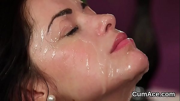Horny beauty gets cumshot on her face eating all the jism Thumb
