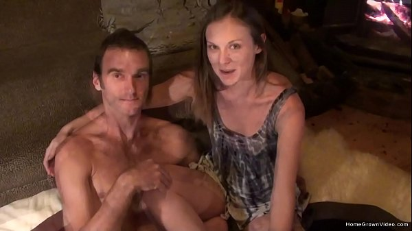 Real couple have intimate sex in front of the fireplace Thumb