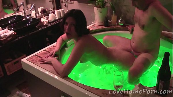 Amateur couple having sex in the green jacuzzi