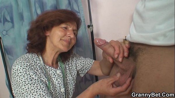 Sewing granny enjoys riding young cock