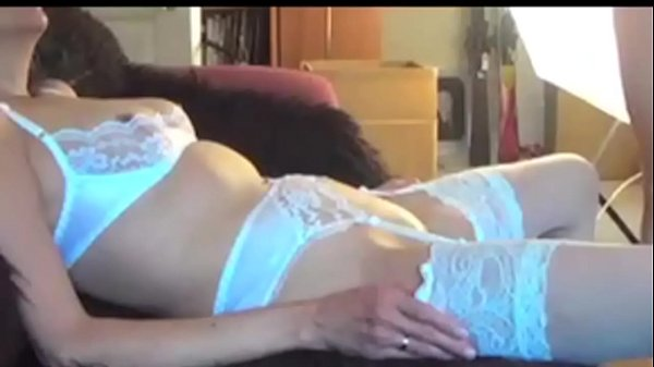 Sexy mature woman in white corset gets fucked at doggystyle while does deepthroat a large dildo on a filthy couch