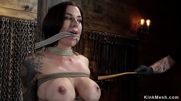 Busty gagged slave is caned on hogtie